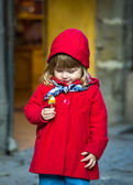 Little child in red coat  — Zdjęcie stockowe