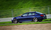 Sport car fast moving on track — Stock Photo