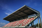Giant tribune with colorized seats — Stockfoto