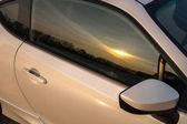 Orange sunset reflections in car glass — ストック写真