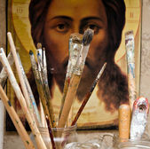 Different brushes in artist work room — Stock Photo