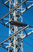 Mast of electricity transmission on blue sky background — Foto de Stock