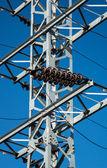 Mast of electricity transmission on blue sky background — Stock Photo