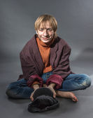 Young actor showing beggar — Stock Photo
