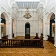 Grand hall in old majestic palace with oak staircase — Stock Photo #49601921