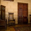 Old oak furniture in entrance hall of palace — Stock Photo #49602139