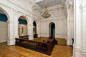 Grand hall in old majestic palace with oak staircase — Stock Photo