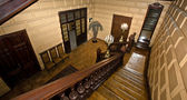 Grand oak staircase in old manor house. Russia. — Stock Photo