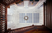 View to the glass ceiling throught grand villa staircase — Stock Photo