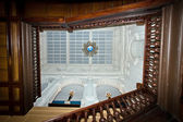 View to the glass ceiling throught grand villa staircase — Stok fotoğraf