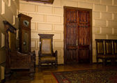 Old oak furniture in entrance hall of palace — Stock Photo