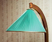 Retro electrical floor lamp with green lampshade — Stock Photo