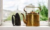 Retro  aeneous teapot and cast iron — Stock Photo