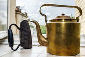 Retro  aeneous teapot and cast iron — Stock Photo