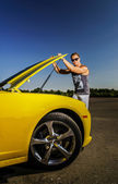 Racing driver with his car — Stock Photo