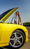 Luxury glamour girl and yellow sport car — Stock Photo