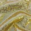 Fabric texture with reflective gold rings with pleats — Stock Photo #51424819