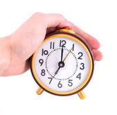 Alarm clock and hand isolated on white — Stock Photo