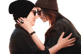 Young fashion hipster couple in love kissing and having passion in spring sunny weather — Stock Photo
