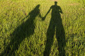 Silhouetted loving couple at sunset — Stock Photo