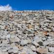 Pile of rocks against a blue sky — Stock Photo #50269041