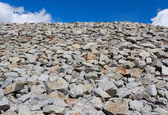 Pile of rocks against a blue sky — Stock Photo