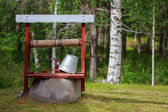 Water well with a bucket — Photo