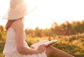 Girl in dress reading book.  — Foto Stock