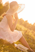 Girl in dress sitting at grass. — Foto Stock
