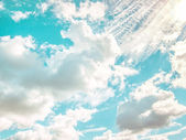 Blue sky background with different shape and size of clouds — Stock Photo