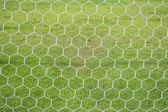 Abstract soccer goal net pattern with green grass  — Stock Photo