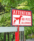 No pets allowed sign on gate in the park  — Stock Photo