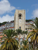 Cathedral belltower against clouds and the sky to Lisbon — Stock Photo