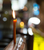 The candle standing on a protection on Walking Street Street in Pattaya on night — Stock Photo