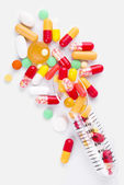 Batcher with various colorful pills — Stock Photo