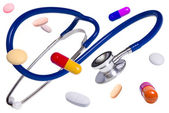 Medical stethoscope with pills and tablets — Stok fotoğraf