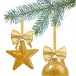 Christmas tree branch with yellow glass ball and star — Stock Photo