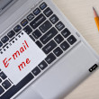 """E-mail me"" note paper on laptop keyboard — Stock Photo #49255319"