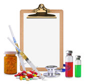 Empty clipboard and medical supplies — Stock Photo