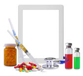 Tablet pc and medical supplies — Stock Photo