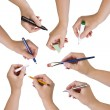Collection of hands holding different stationary objects — Stock Photo #49297425