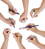 Collection of hands holding different stationary objects — Stock Photo
