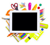 Tablet computer with school and office supplies — Stock Photo