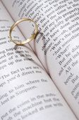 Wedding ring on the book — Stock Photo