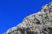 Rock on sky background — Stock Photo