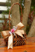 Woven basket with ribbon — Stock Photo