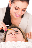 Application of false eyelashes — Stock Photo