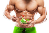 Shaped and healthy body man holding a fresh salad bowl,shaped ab — Stock Photo