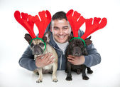 French bulldog with reindeer horns and owner — Stock Photo