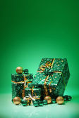 Gift boxes and christmas balls,Isolated on green background — Stock Photo